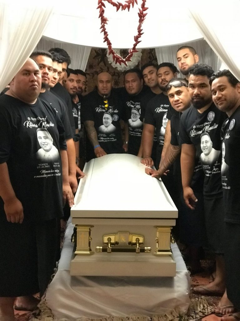 Kitiona with pallbearers